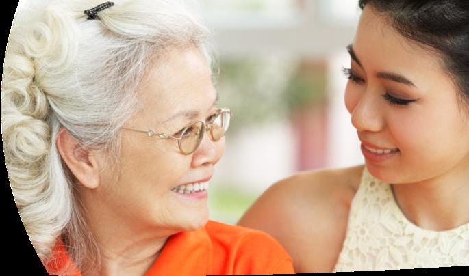 asian caregiver and female senior